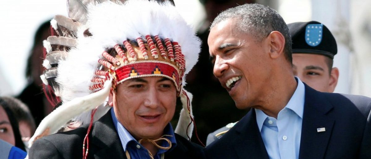 U.S. President Barack Obama talks to the Standing Rock Sioux Tribe Chairman David Archambault II (L) as they attend the Cannon Ball Flag Day Celebration at the Cannon Ball Powwow Grounds on the Standing Rock Sioux Reservation in North Dakota, June 13, 2014. REUTERS/Larry Downing/File Photo