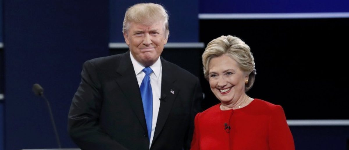 Republican U.S. presidential nominee Donald Trump and Democratic U.S. presidential nominee Hillary Clinton shake hands at the start of their first presidential debate at Hofstra University in Hempstead