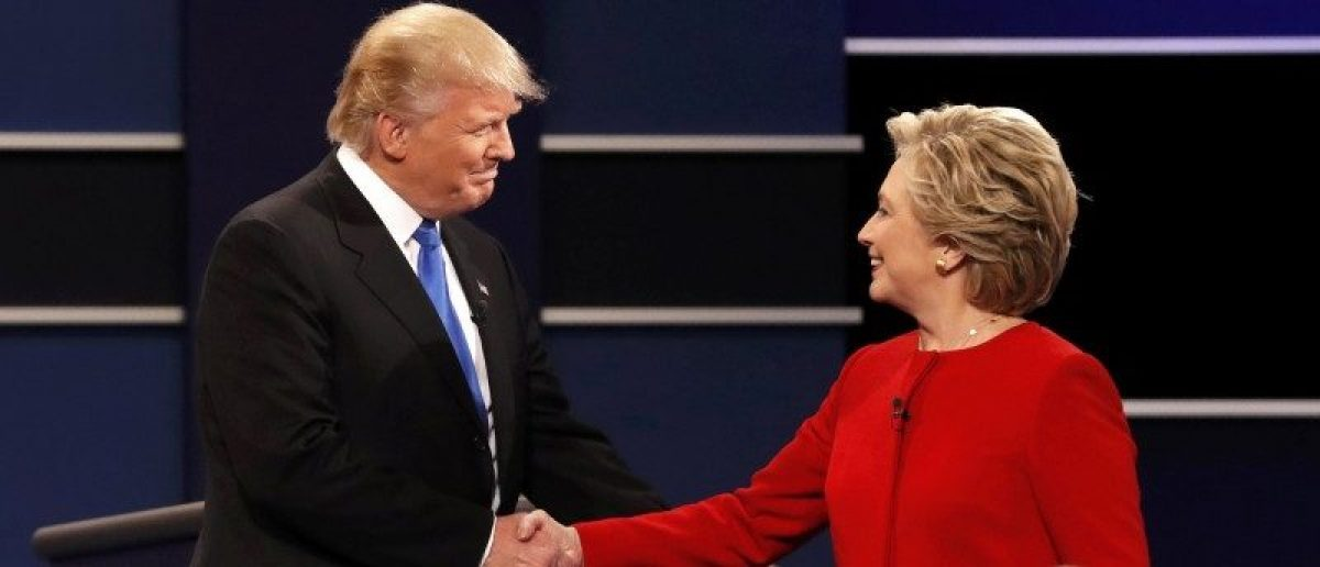 Republican presidential nominee Donald Trump shakes hands with Democratic presidential nominee Hillary Clinton at the start of their first presidential debate at Hofstra University in Hempstead, New York, September 26, 2016. REUTERS/Mike Segar