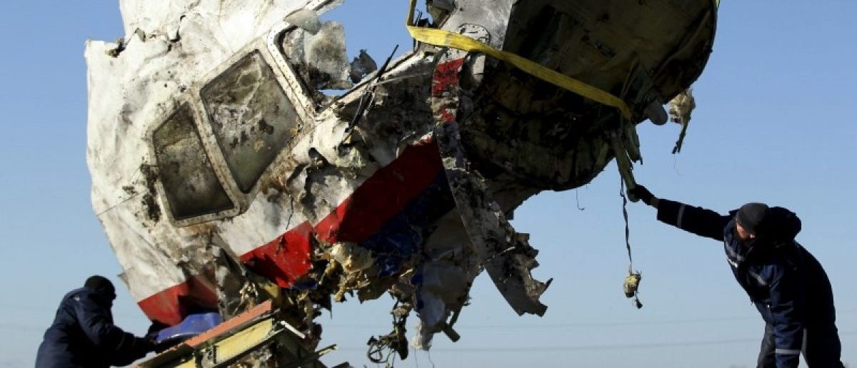 Local workers transport a piece of the Malaysia Airlines flight MH17 wreckage at the site of the plane crash near the village of Hrabove (Grabovo) in Donetsk region, eastern Ukraine November 20, 2014. REUTERS/Antonio Bronic
