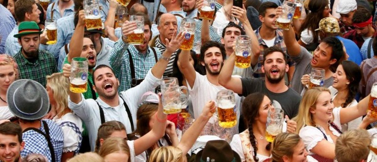 Visitors cheer with beer during the opening day of the 183rd Oktoberfest in Munich, Germany, September 17, 2016. REUTERS/Michaela Rehle/File Photo