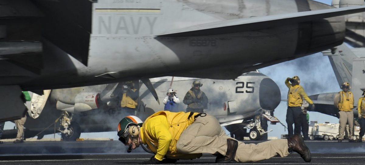 PACIFIC OCEAN (Nov. 12, 2012) Lt. Jeffrey Herzog takes cover from the jet blast of an F/A-18F Super Hornet assigned to the Black Nights of Strike Fighter Squadron (VFA) 154 as it launches from the aircraft carrier USS Nimitz (CVN 68) during the disembarkation of Carrier Air Wing (CVW) 11. Nimitz is currently in transit to Naval Air Station North Island after successfully completing the ship's Joint Task Force Exercise. (U.S. Navy photo by Mass Communication Specialist 3rd Class Ryan J. Mayes/Released) 121112-N-RC246-290 Join the conversation http://www.facebook.com/USNavy http://www.twitter.com/USNavy http://navylive.dodlive.mil