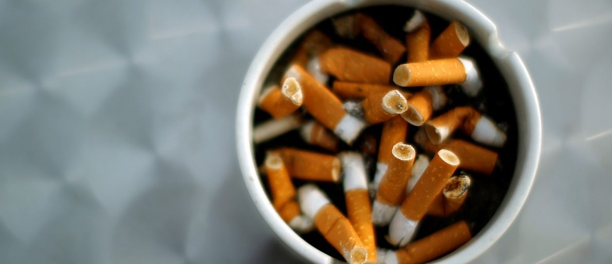 An ash tray with cigarette butts is pictured in Hinzenbach, Austria February 5, 2012. REUTERS/Lisi Niesner/File Photo