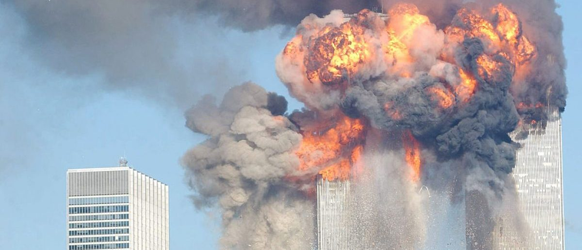 Fiery blasts rocks the World Trade Center after being hit by two planes September 11, 2001 in New York City. (Photo by Spencer Platt/Getty Images)