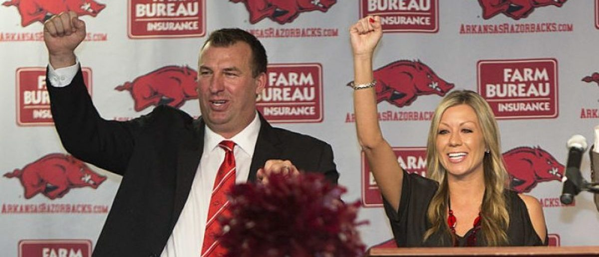 Former Wisconsin Badger Head Coach Bret Bielema, his wife Jen and Athletic Director Jeff Long call the Hogs at the press conference to introduce Bret as the new Head Coach of the Arkansas Razorbacks on December 5, 2012 in Fayetteville, Arkansas. (Photo by Wesley Hitt/Getty Images)