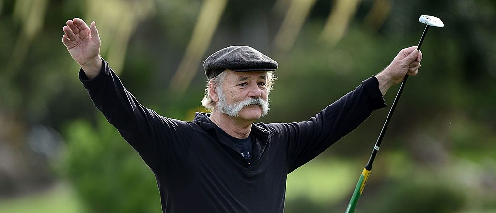 Actor Bill Murray walks across a green during the first round of the AT&T Pebble Beach National Pro-Am at the Monterey Peninsula Country Club on February 7, 2013 in Pebble Beach, California