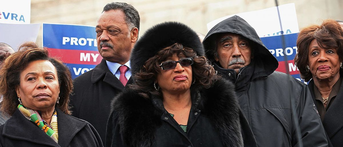 Rep. Barbara Lee (D-CA), Rev. Jesse Jackson, Rep. Corrine Brown (D-FL), Rep. Charles Rangel (D-NY) and Rep. Maxine Waters (D-CA) rally with fellow members of Congress on the steps of the U.S. Supreme Court February 27, 2013 in Washington, DC. Leaders from Congress joined civil rights icons to rally as the court prepared to hear oral arguments in Shelby County v. Holder, a legal challenge to Section 5 of the Voting Rights Act. (Photo by Chip Somodevilla/Getty Images)