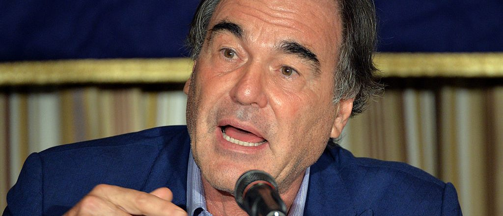 Oliver Stone speaks before press in Tokyo on August 12, 2013