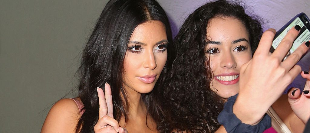 """Kim Kardashian poses for a selfie with a fan as she arrives to promote her new fragrance """"Fleur Fatale"""" at a Spice Market event on November 18, 2014 in Melbourne, Australia"""