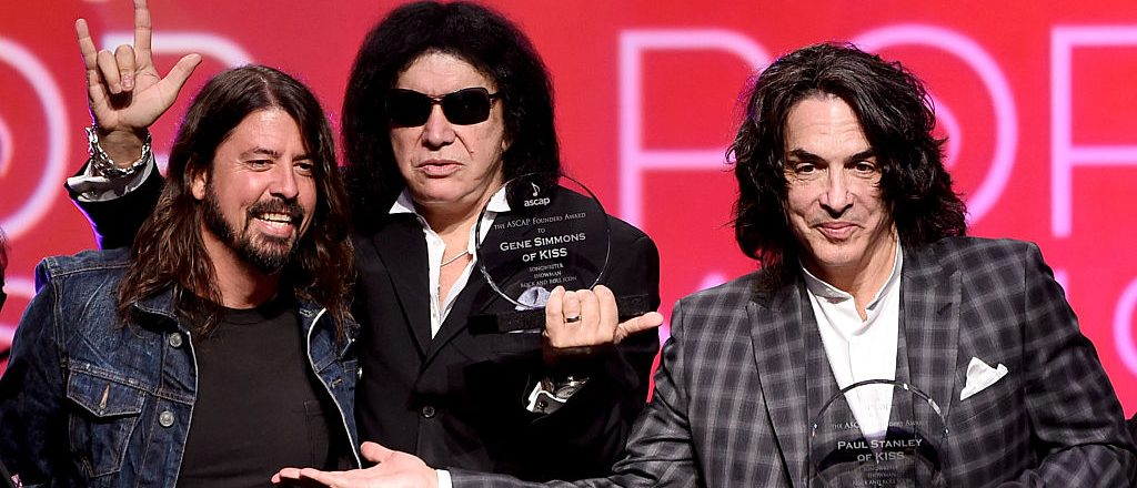 (L-R) Musician Dave Grohl presents musicians Gene Simmons and Paul Stanley of KISS the ASCAP Founders Award at the 32nd Annual ASCAP Pop Music Awards at the Loews Hollywood Hotel on April 29, 2015 in Los Angeles. (Photo by Kevin Winter/Getty Images)