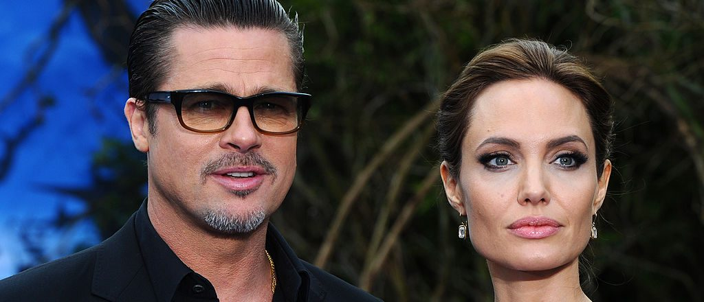"Brad Pitt and Angelina Jolie attend a private reception as costumes and props from Disney's ""Maleficent"" are exhibited in support of Great Ormond Street Hospital at Kensington Palace on May 8, 2014 in London"