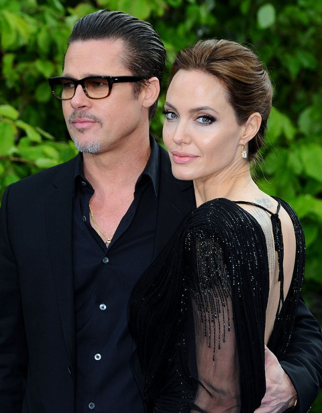 "Brad Pitt and Angelina Jolie attend a private reception as costumes and props from Disney's ""Maleficent"" are exhibited in support of Great Ormond Street Hospital at Kensington Palace on May 8, 2014 in London, England"
