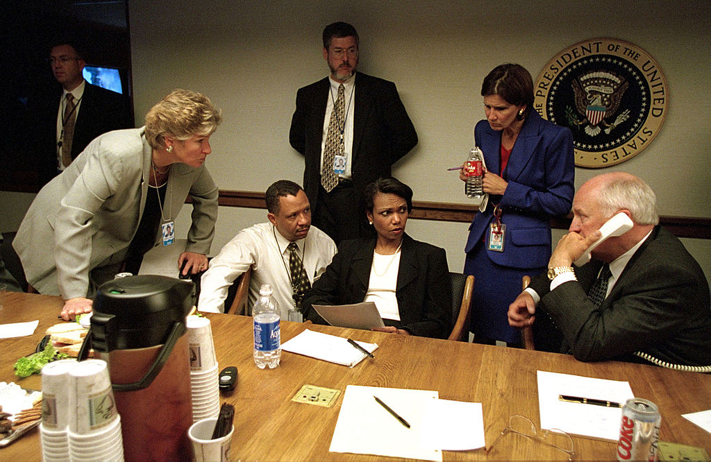 U.S. Vice President Dick Cheney (R) Speaks To President George W. Bush By Phone September 11, 2001 Inside The Operations Center At The White House After The Terrist Attacks In Washington And New York. With Cheney Are Staff Members, Including Presidential Counselor Karen Hughes (L) And National Security Adviser Condoleezza Rice (C). (Photo By The White House/Getty Images)