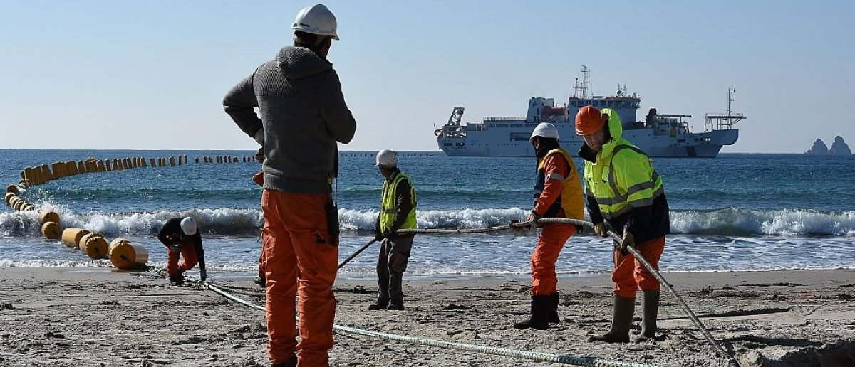 "Employees of Orange Marine work on the installation of the very high speed submarine cable ""SEA-ME-WE 5"" linking Singapore to France, on March 1, 2016 in La Seyne-sur-Mer, southern France. BORIS HORVAT/AFP/Getty Images"