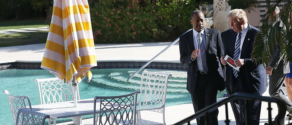Donald Trump walks with Ben Carson before he receives his endorsement at the Mar-A-Lago Club on March 11, 2016 in Palm Beach, Florida (Getty Images)