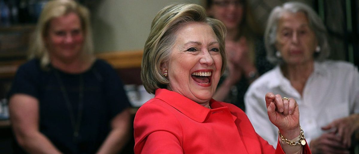 JENKINTOWN, PA - APRIL 22:  Democratic presidential candidate former Secretary of State Hillary Clinton laughs during a Breaking Economic Barriers Conversation at Curds 'n Whey restaurant (Photo by Justin Sullivan/Getty Images)