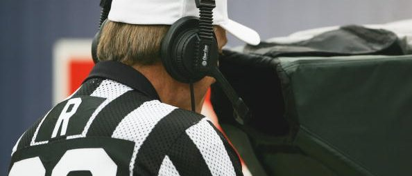 Referee Bernie Kukar looks at a play in the replay booth during the Philadelphia Eagles game against the Denver Broncos at INVESCO Field at Mile High on October 30, 2005 in Denver, Colorado. The Broncos defeated the Eagles 49-21. (Photo by Doug Pensinger/Getty Images)