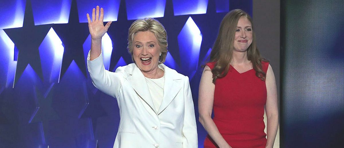 Democratic presidential nominee Hillary Clinton waves to the crowd after being introduced by her daughter Chelsea Clinton (R) on the fourth day of the Democratic National Convention at the Wells Fargo Center, July 28, 2016 in Philadelphia, Pennsylvania. [Alex Wong/Getty Images]