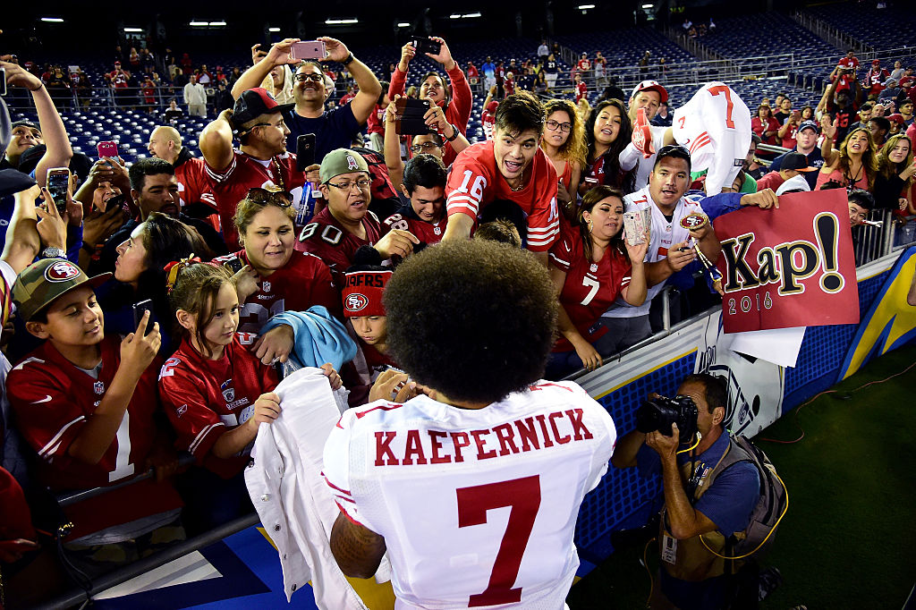 SAN DIEGO, CA - SEPTEMBER 01: Colin Kaepernick #7 of the San Francisco 49ers signs autographs for fans after a 31-21 win over the San Diego Chargers during a preseason game at Qualcomm Stadium on September 1, 2016 in San Diego, California. (Photo by Harry How/Getty Images)