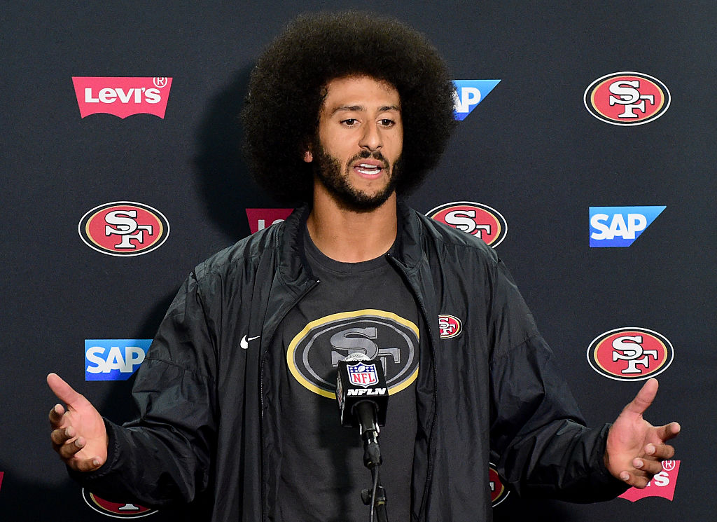 Kaepernick speaks at a post game press conference. (Photo by Harry How/Getty Images)