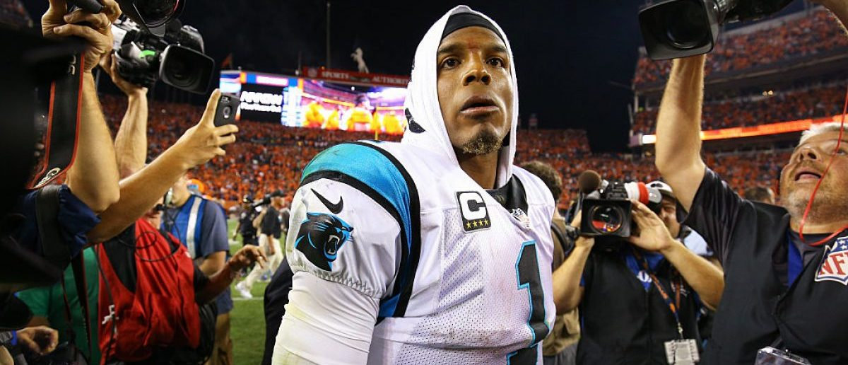 Quarterback Cam Newton #1 of the Carolina Panthers walks off the field after losing to the Broncos 21-20 at Sports Authority Field at Mile High on September 8, 2016 in Denver, Colorado