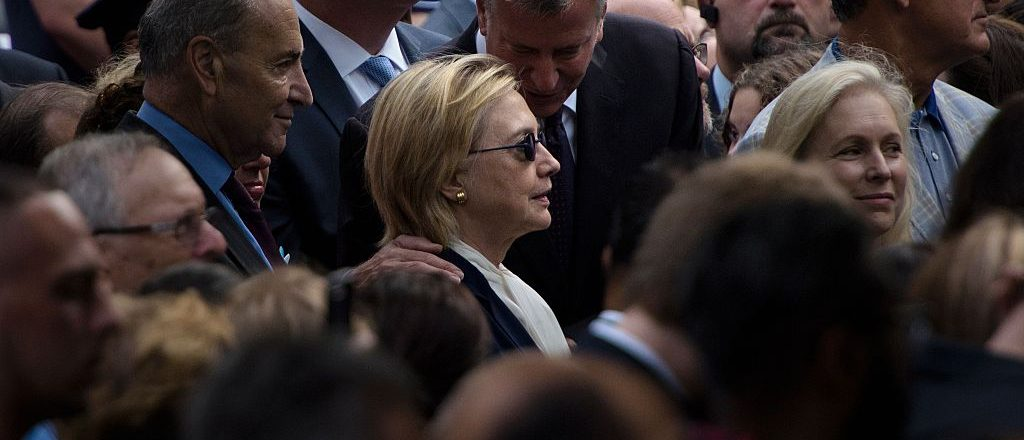 New York City Mayor Bill de Blasio speaks to US Democratic presidential nominee Hillary Clinton during a memorial service at the National 9/11 Memorial September 11, 2016 in New York (Getty Images)