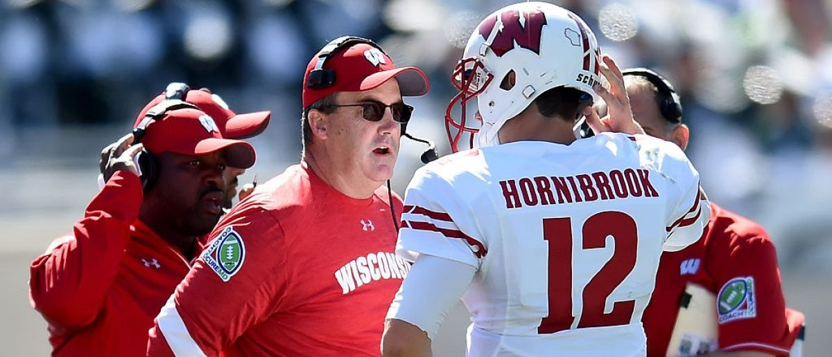 Paul Chryst, head coach of the Wisonsin Badgers, talks to Alex Hornibrook #12 of the Wisconsin Badgers during the game against the Michigan State Spartans at Spartan Stadium on September 24, 2016 in East Lansing, Michigan. (Photo by Bobby Ellis/Getty Images)