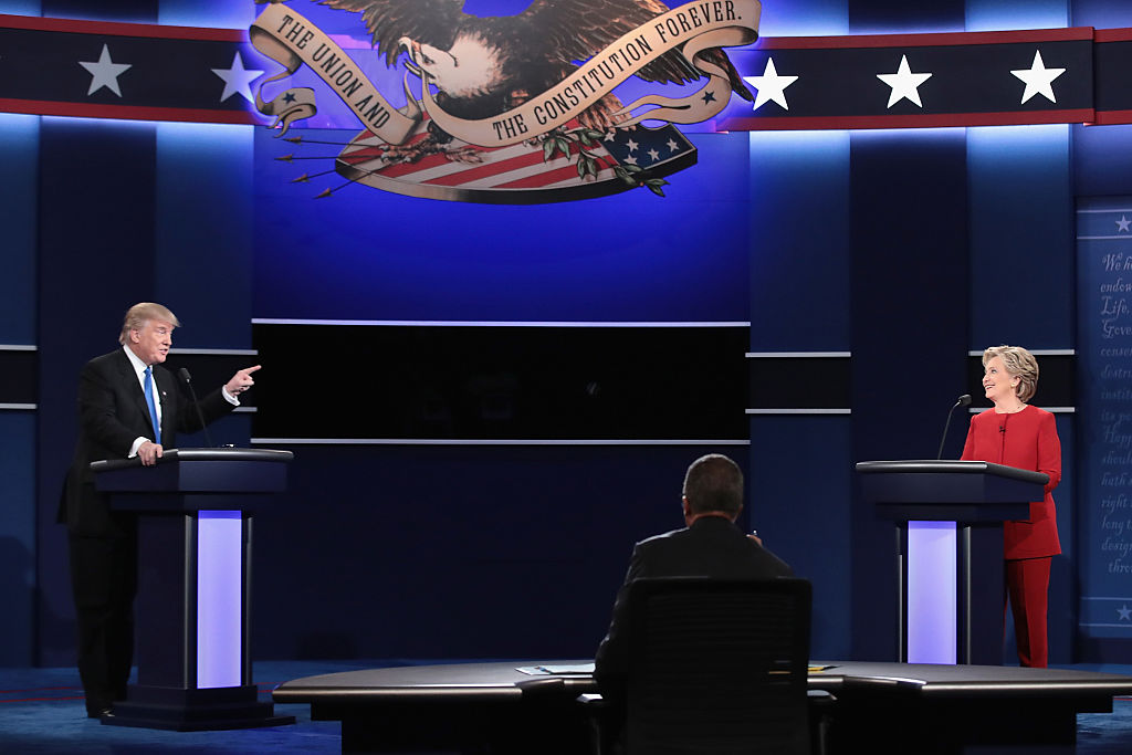 Donald Trump speaks as Hillary Clinton and Moderator Lester Holt listen during the Presidential Debate at Hofstra University (Getty Images)