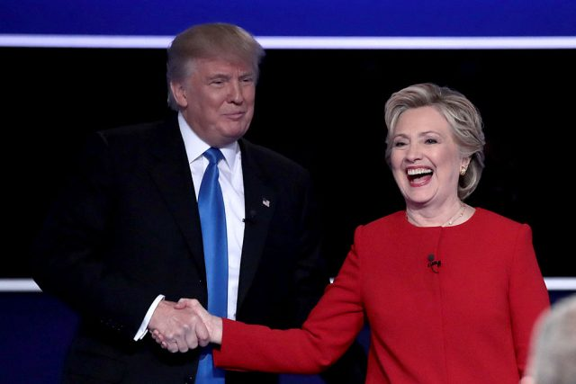 Republican presidential nominee Donald Trump and Democratic presidential nominee Hillary Clinton shake hands after the Presidential Debate at Hofstra University on September 26, 2016 in Hempstead, New York