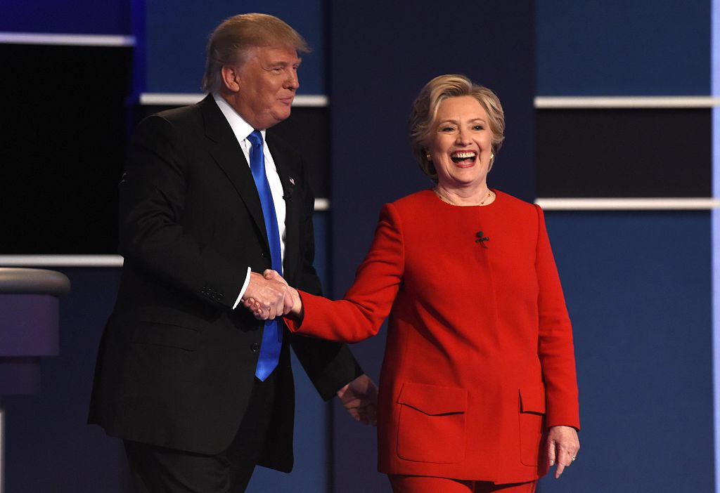 Democratic nominee Hillary Clinton shakes hands with Republican nominee Donald Trump after the first presidential debate at Hofstra University in Hempstead, New York on September 26, 2016