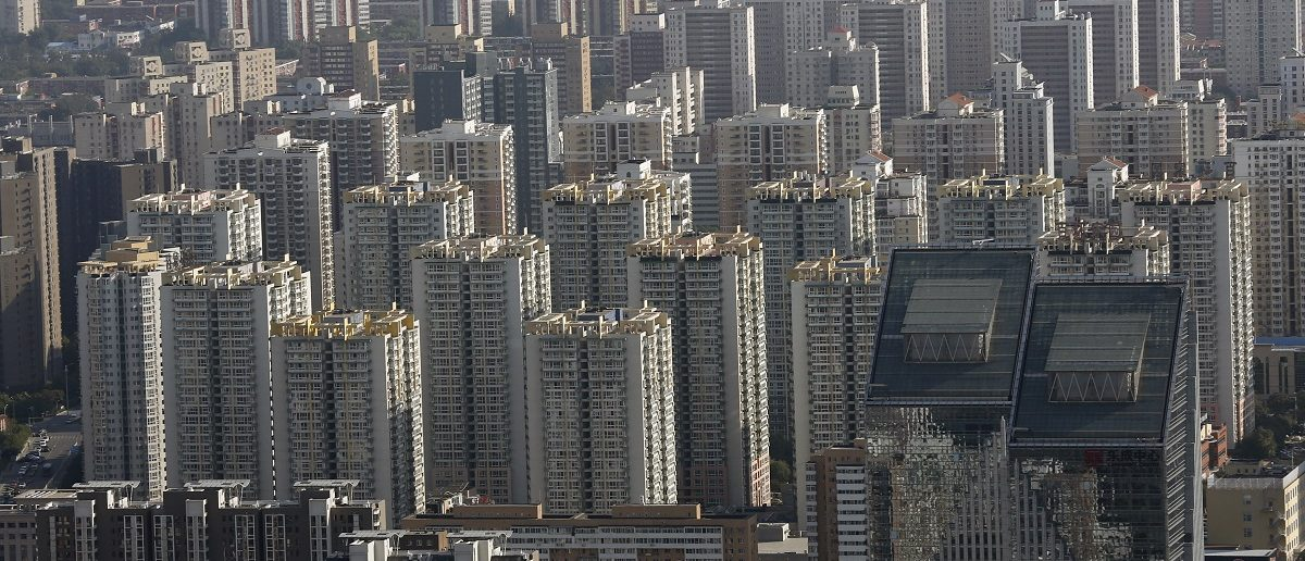 Commercial buildings and apartments are seen in central Beijing, China, September 19, 2015. REUTERS/Kim Kyung-Hoon