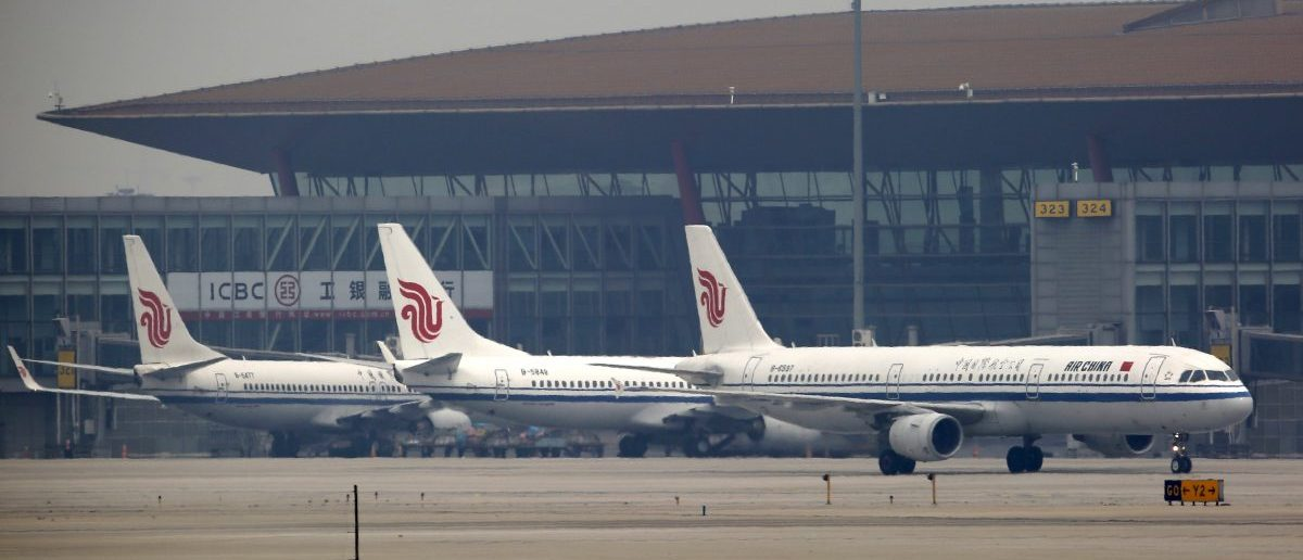 Planes belonging to Air China are parked on the tarmac of Beijing Capital International Airport in Beijing, China, March 28, 2016. REUTERS/Kim Kyung-Hoon