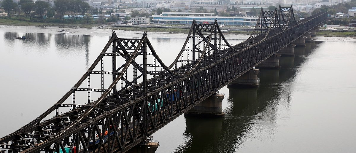 Trucks cross Friendship Bridge from China's Dandong, Liaoning province, to North Korea's Sinuiju September 12, 2016. REUTERS/Thomas Peter