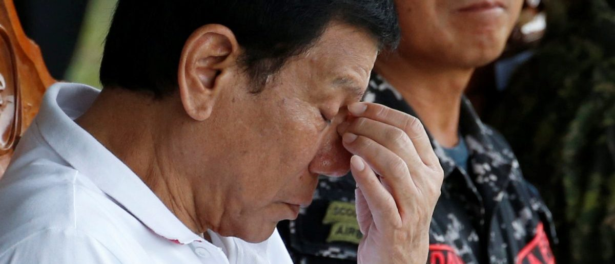 Philippine President Rodrigo Duterte reacts during a visit at the military's Scout Ranger Camp Tecson in San Miguel, Bulacan in northern Philippines September 15, 2016. REUTERS/Erik De Castro