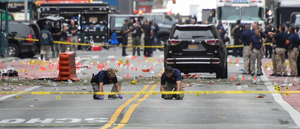 Federal Bureau of Investigation (FBI) officials mark the ground near the site of an explosion in the Chelsea neighborhood of Manhattan, New York, U.S. September 18, 2016. (REUTERS/Rashid Umar Abbasi)