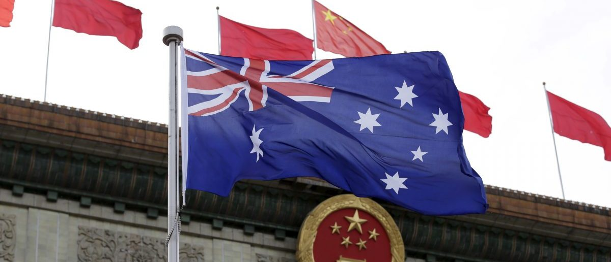 Australian flag flutters in front of the Great Hall of the People in Beijing, China, April 14, 2016. REUTERS/Jason Lee