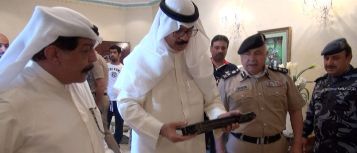 Kuwait's Deputy Prime Minister and Interior Minister Sheikh Mohammad al-Hamad al-Sabah (C) look at weapons that Kuwaiti authorities said were smuggled from Iran by suspected members of a militant cell in Kuwait August 13, 2015. Kuwait News Agency/Handout via REUTERS/RTX2F9YV