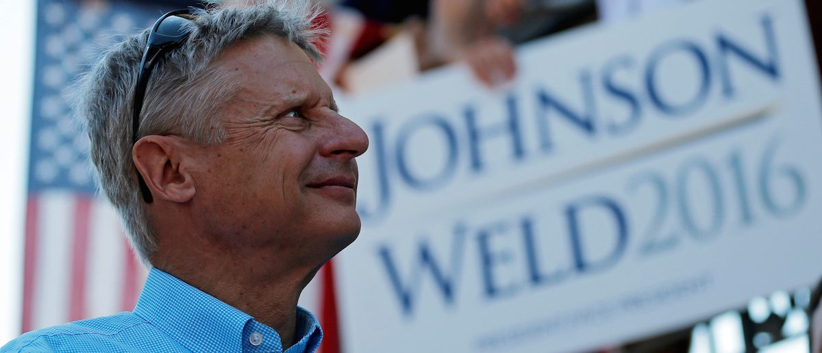 Libertarian presidential candidate Gary Johnson listens as his running mate vice presidential candidate Bill Weld speaks at a campaign rally in Boston, Massachusetts, U.S., August 27, 2016. REUTERS/Brian Snyder