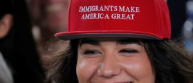 "Audience member Ana Gomez wears a cap reading ""Immigrants Make America Great"" in the style of hats worn by U.S. Republican presidential candidate Donald Trump at a campaign Voter Registration Rally with U.S. Democratic presidential nominee Hillary Clinton. REUTERS/Brian Snyder - RTX2OEI6"