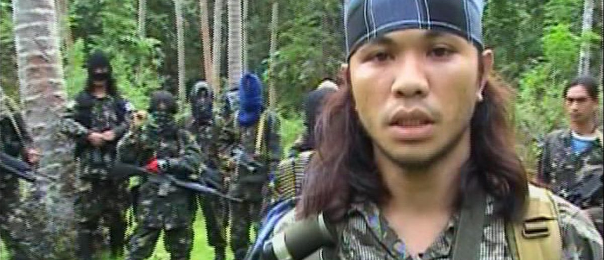 An Abu Sayyaf rebel is seen in the Philippines in this video grab made available February 6, 2009. (REUTERS/Philippine)