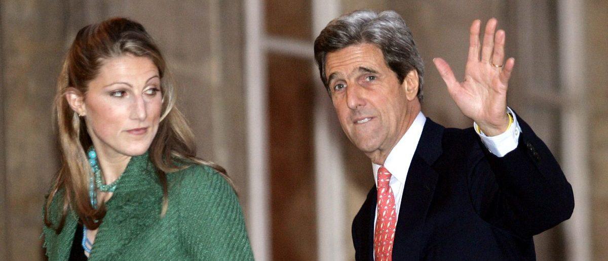 Then-U.S. Senator John Kerry waves as he escorts his daughter Vanessa. (Reuters/John Schults)