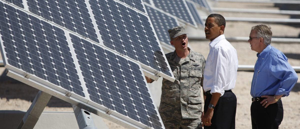 U.S. President Barack Obama (C) inspects an array of solar panels with U.S. Senate Majority Leader Harry Reid (R) and Col. Howard Belote, base commander at Nellis Air Force Base in Las Vegas, Nevada May 27, 2009. Obama marked the 100th day of the American Recovery and Reinvestment Act by highlighting the development and use of geothermal and solar energy. (REUTERS/Jason Reed)