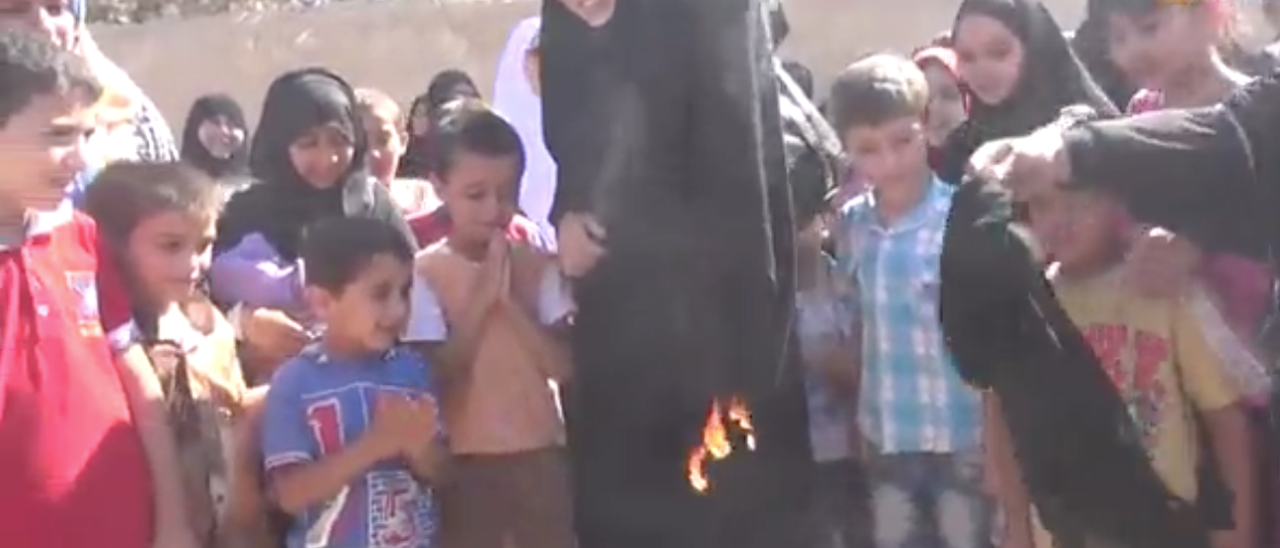 The Daily Mail video screen shot of Syrian women burning a burka.