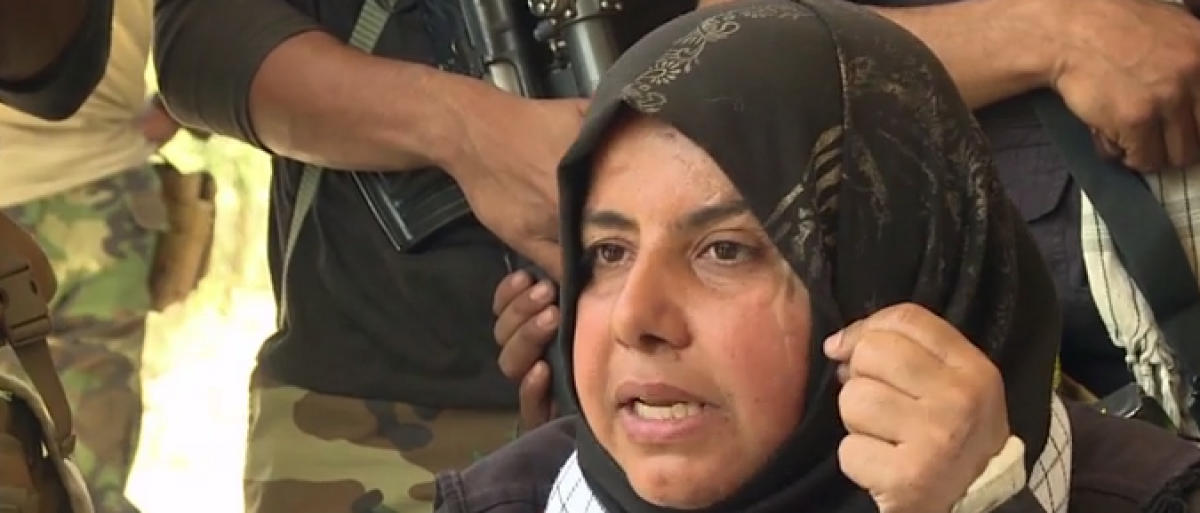 Um Hanadi shows scars from battling ISIS. (screenshot from CNN video)
