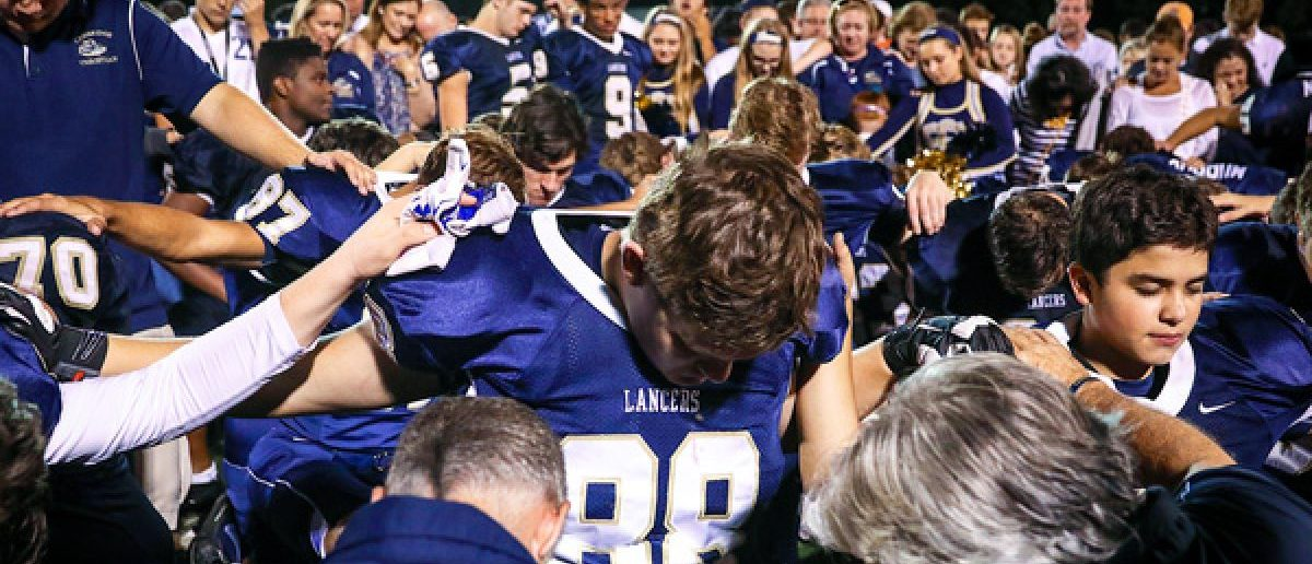 an essay on the issue of praying at high school football games