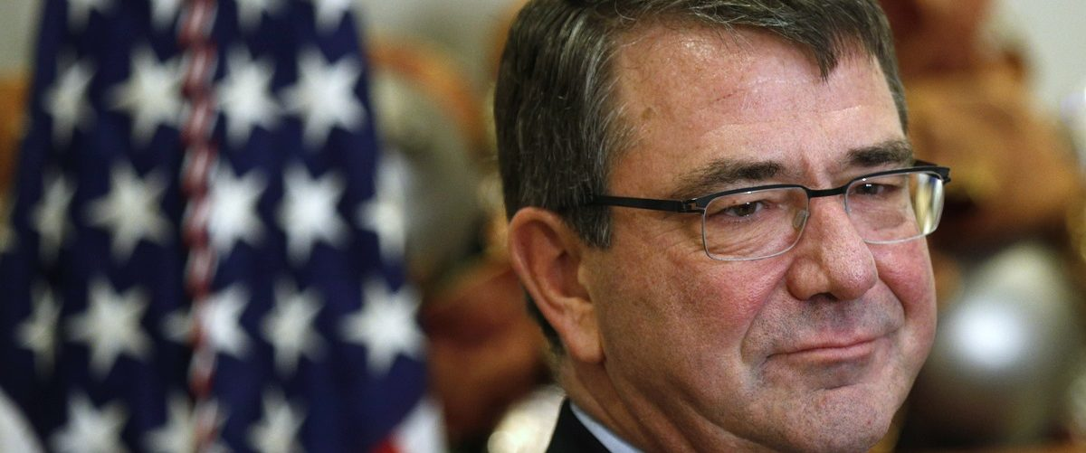 Former Pentagon official Ash Carter listens as he is nominated by U.S. President Barack Obama to be Obama's next defense secretary, at the White House in Washington
