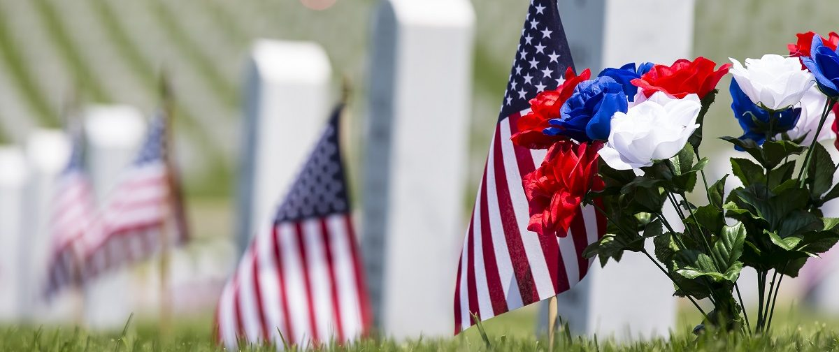Cemetery memorial with American flag. (Action Sports Photography/Shutterstock.)