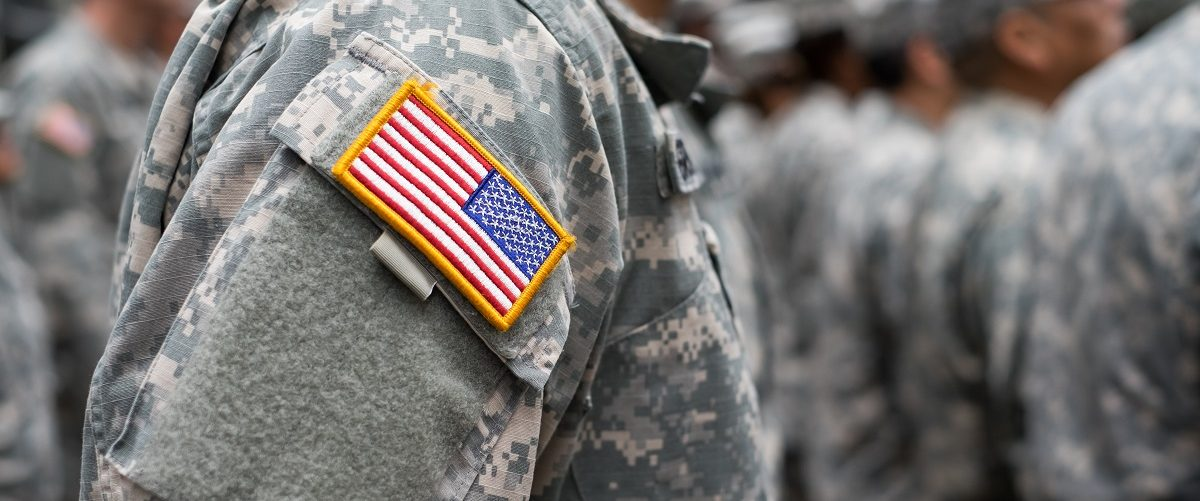 U.S. flag patch on uniform. Christopher Lyzcen/Shutterstock.