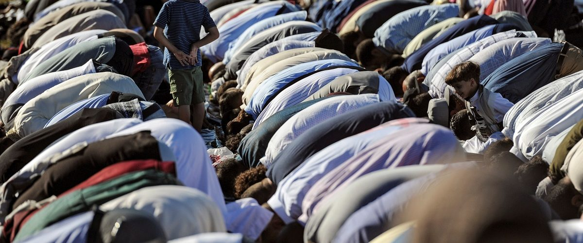 People participate in a group prayer session for the Muslim holiday Eid al-Adha in the Brooklyn borough of New York City