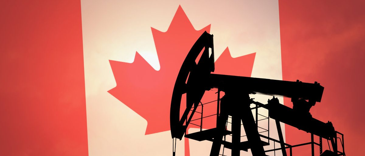 Oil pump on background of flag of Canada (Shutterstock/Anton Watman)